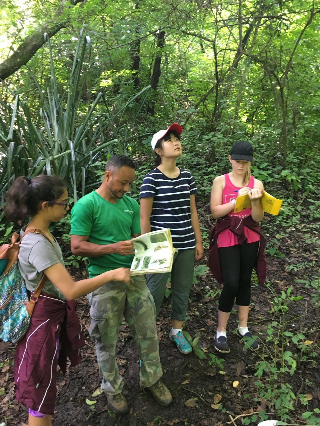 A group of high school volunteers help identify the wildlife found in Barra Honda National Park.